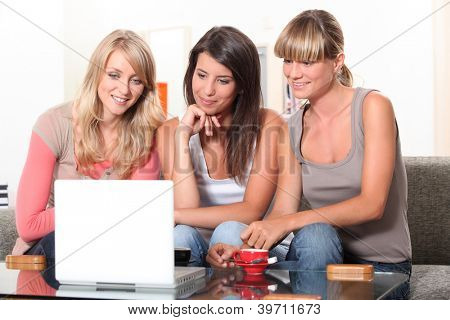Young women watching a film on a laptop