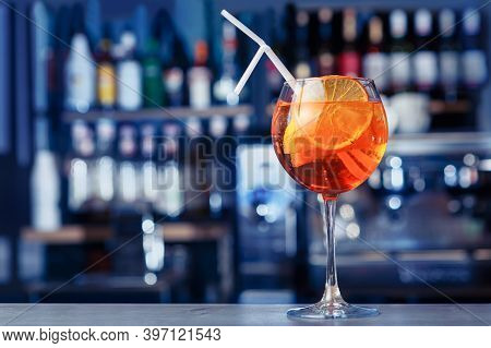 Aperol Cocktail Decorated With Orange At Bright Bar Counter Background. Soft Focus, Selective Focus