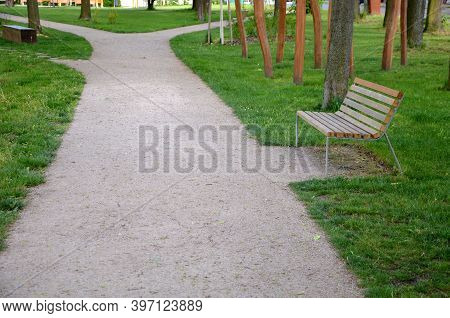 Wooden Paneling Gray Metal Bench By The Park Path Side View Wooden With Backrest Beige Path For Pede
