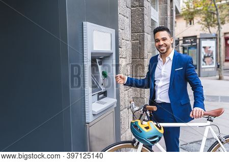 Young Business Man Getting Cash From Atm.