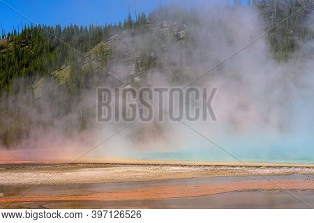Steam Reflects Color Of Grand Prismatic In Yellowstone National Park