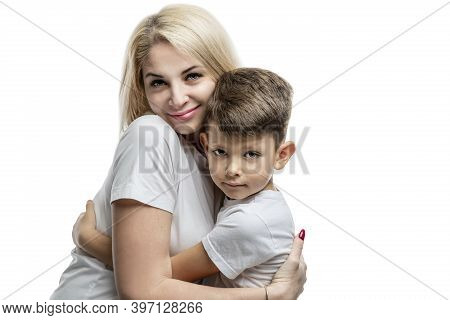 Mom And Son Hug Tenderly. Love, Understanding And Tenderness. Close-up. Isolated On White Background