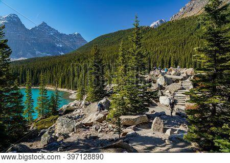 Alberta, Canada - Sep 27 2020 : Moraine Lake Lakeshore Trail In Summer Sunny Day Morning. Beautiful