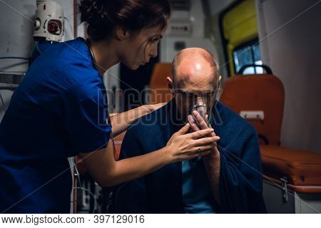 Paramedic Presses An Oxygen Mask To A Mans Face, Who Got Into An Accident.
