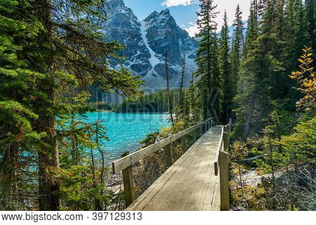 Moraine Lake Beautiful Landscape In Summer To Early Autumn Sunny Day Morning. Sparkle Turquoise Blue