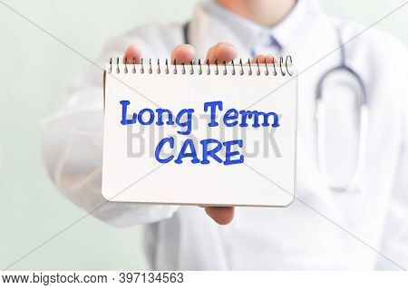 Doctor Holding A Card With Text Long Term Care, Medical Concept