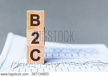Letter Of The Alphabet Of B2c On A Grey Background. B2c - Business-to-consumer