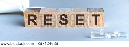 Reset Is A Word Written In Black Letters On Wooden Cubes
