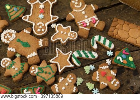 Assortment of gingerbread cookies on a rustic wooden table