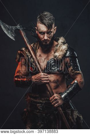 Barbaric And Grimy Northern Vandal In Light Armour With Fur Holding His Huge Axe On His Shoulder In