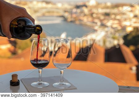 Pouring Of Fortified Dessert Ruby, Tawny Port Wines In Glasses With View On Douro River, Porto Lodge