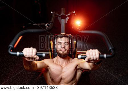 Handsome Young Man Doing Bench Press Workout In Gym. Orange Warm Light. Strong Abs. Heavy Lift.