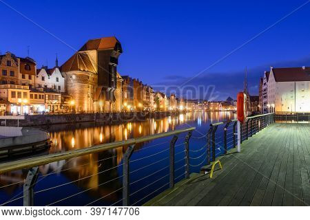 Famous Old Port Crane Of Gdansk And Motlawa River At Night. Poland, Europe.