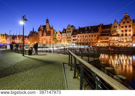 Gdansk, Poland - November 29, 2020: Promenade At Motlawa River With Famous Historic Architecture Of