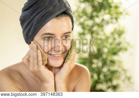 Young Woman Washing Her Face With Reusable Round Crocheted Pads In Bathroom. Diy Washable Knitted Ma