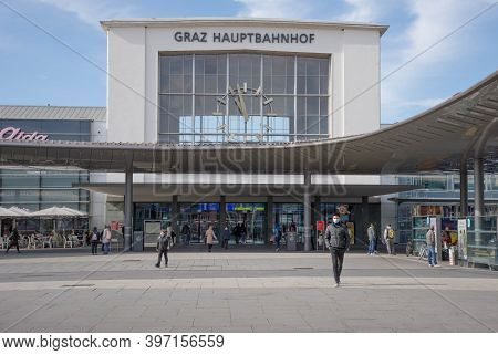 Graz, Austria-october 14, 2020: People In Front Of Central Train Station Wearing Face Masks For Prot