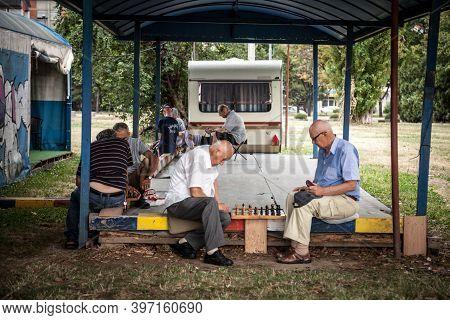 Belgrade, Serbia - July 2, 2017: Old Senior Men Playing Chess In A Park In Belgrade, Serbia. Kalemeg