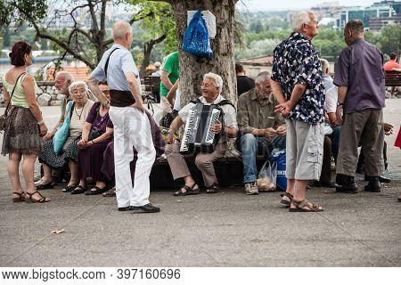 Belgrade, Serbia - July 2, 2017: Serbian Old People Having Fun And Laughing Playing Accordeon In The