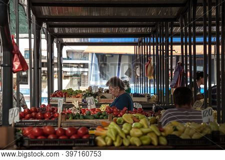 Belgrade, Serbia - September 14, 2019: Senior Old Woman Selling Fruits And Vegetables, Mainly Pepper