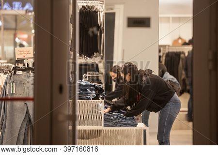Belgrade, Serbia - November 9, 2020: Staff Worker Employee Folding Jeans In A Fashion Retailer Cloth