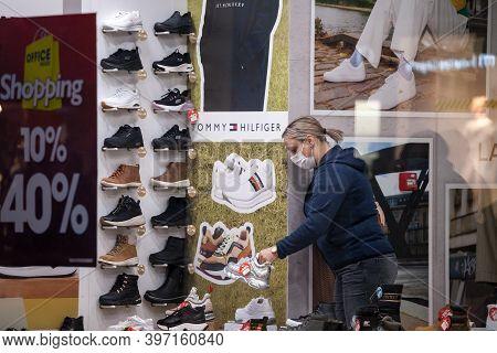 Belgrade, Serbia - November 11, 2020: Employee Of A Shoe Store Footwear Boutique Standing Alone Arou
