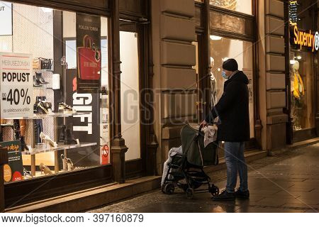 Belgrade, Serbia - November 15, 2020: A Father And His Baby Child, In A Stroller, Waiting In Front O
