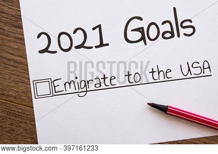 Planner Of Goals And Plans For 2021, A Sheet Of Paper With The Inscription Emigrate To The Usa From