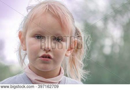 Portrait Of A Cheerful And Funny Cute Positive Five Year Old Girl With White Hair.