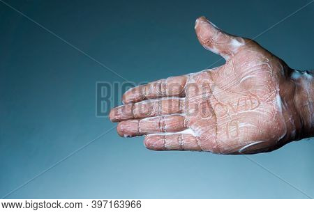 Coronavirus Becomes Ineffective With Soap. The Man's Soapy Hand Written