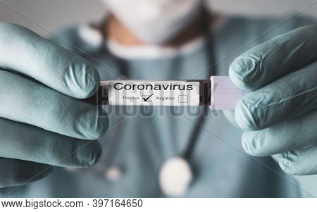 Positive Result Of The Coronavirus Test, Covid-19. Doctor Showing The Result Of Blood Test. 2019 Nov