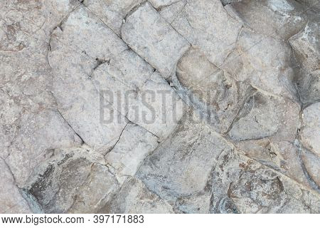 Cracked Clay With Traces Of The Water Environment Close-up Visible Large Cracks And Fragments Of Cla