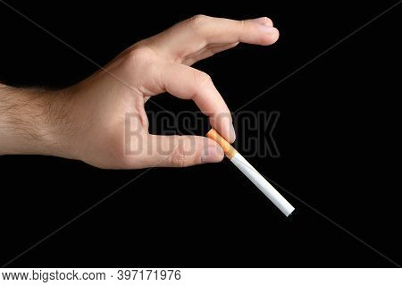 Male Hand Holding In Between Fingers Unlit Cigarette Concept: Bad Habit Smoking Lung Cancer Smog