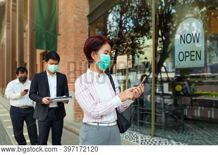 Reopened Businesses After Covid-19 Lockdown , People Wearing Mask And Keep Social Distancing To Avoi