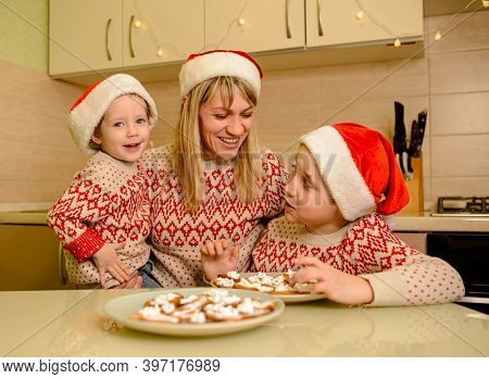 Cute Caucasian Child Boys Decorating Gingerbread Cookies With Fun. Children Decorate Christmas Cooki