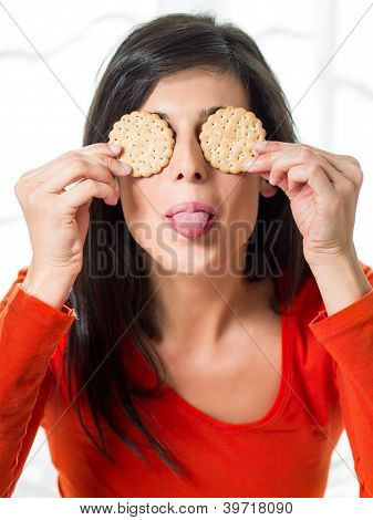 Woman Taunting Diet With Crackers