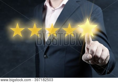 Review And Rating Increase Company Concept, Businessman Hand Touching Five Star. Review, Increase Ra