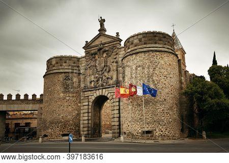 Hinge door in Toledo town with historical buildings in Spain.