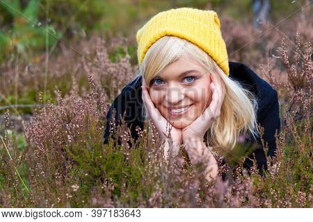 Portrait of smiling blond teen woman on the moor