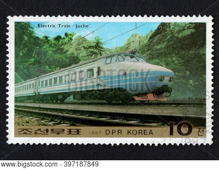 Dpr Korea - Circa 1987: Korean Stamp Dedicated To Railway Transport. History Of Electric Train In Ko