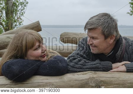 Romantic Heterosexual Lover Couple Of Middle-aged Looks At Each Other. Family, Relationship Concept.