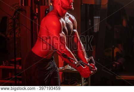Machine In The Gym. Fitness Man Execute Exercise With Exercise-machine Cable Crossover In Gym. Hands