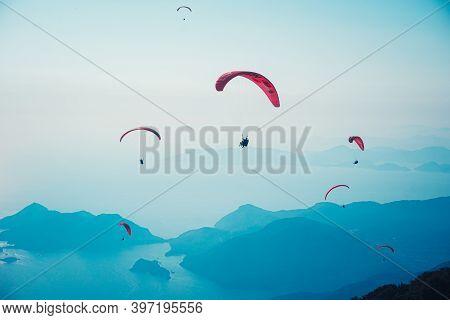 Fethiye, Mugla / Turkey August 28 2020: Paragliding In The Sky. Paraglider Tandem Flying Over The Se