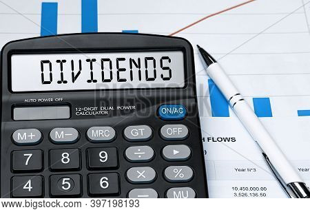 Calculator With The Word Dividends On The Display. Money, Finance And Business Concept