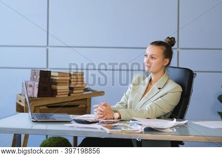Bored Or Sad Woman Working At Office Job. Negative Work Concept. Tired Businesswoman Sitting At Desk