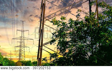 High Voltage Pole. High Voltage Tower On Sunset. Industrial View Of High Voltage Lines.