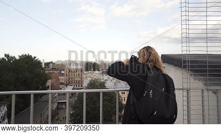 Pretty Young Tourist Taking Photographs While Sightseeing. Action. Woman Walking In The Street And P
