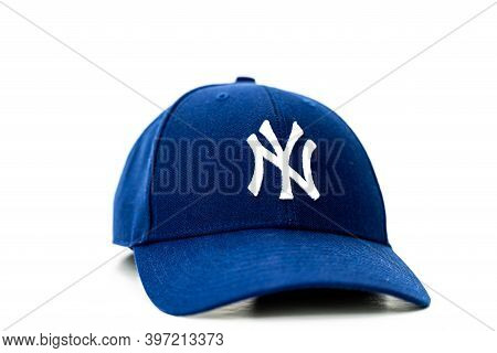 Blue Baseball Hat With Ny Logo In White On The Front. Isolated On White Background.