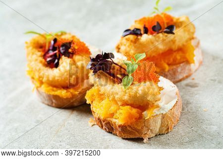 canape with fried calamari and caviar