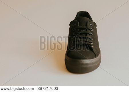 Unisex black canvas sneakers minimal fashion