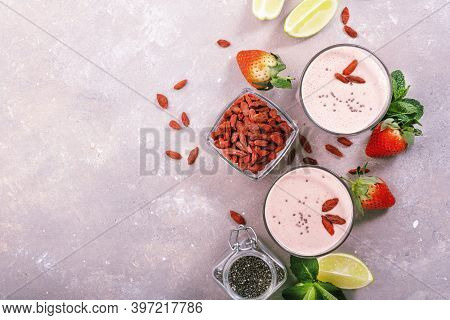 Healthy Blended Drink. Organic Vegan Non Dairy Smoothie With Strawberry And Goji Berries, Chia Seeds